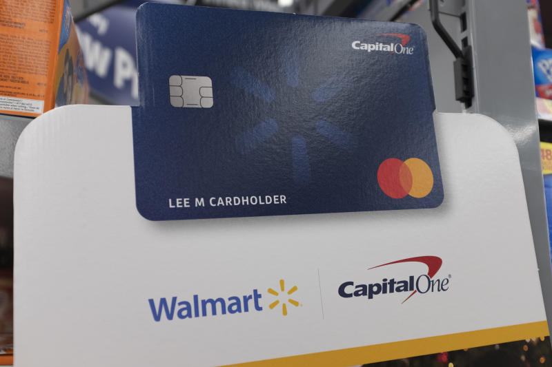A Capital One Walmart credit card sign is seen at a store in Mountain View, California, United States on Tuesday, November 19, 2019. (Photo by Yichuan Cao/NurPhoto via Getty Images)