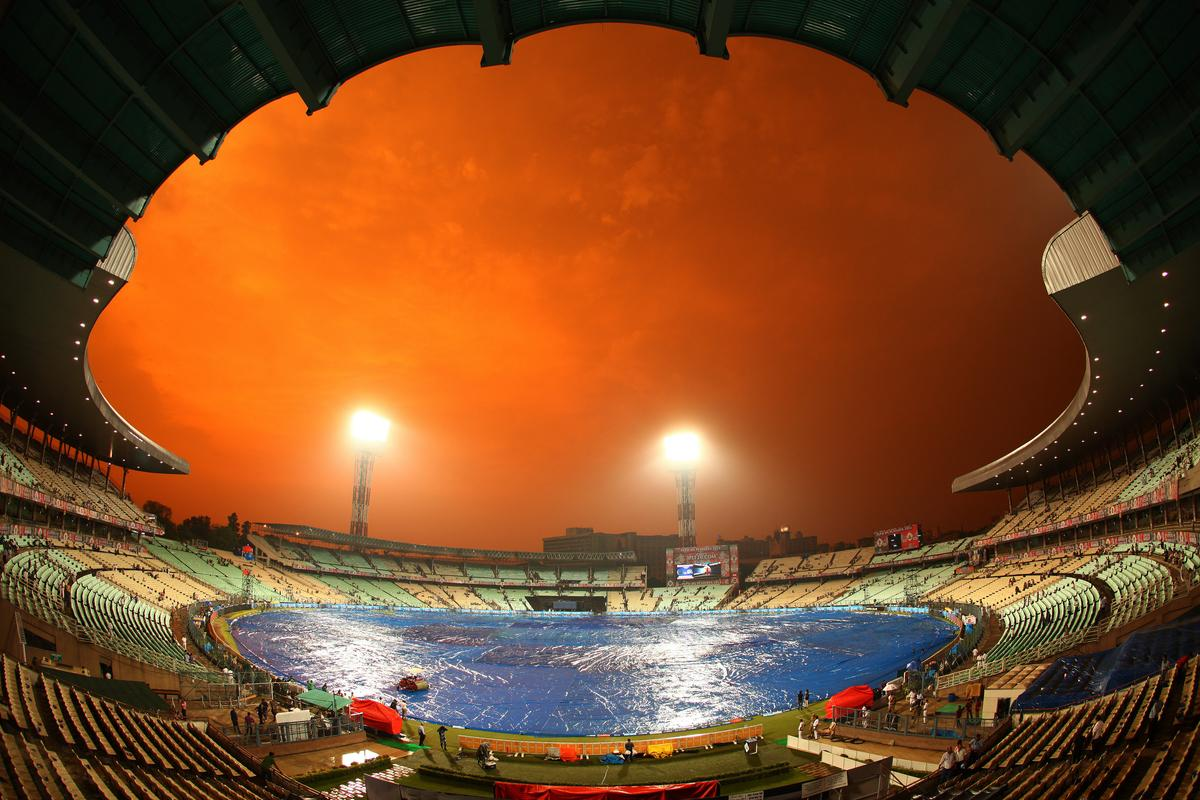 The sun sets as the rain falls over Eden gardens during the 2nd Qualifying match of the Pepsi Indian Premier League between The Rajasthan Royals and the Mumbai Indians  held at the Eden Gardens Stadium in Kolkata on the 24th May 2013..Photo by Ron Gaunt-IPL-SPORTZPICS      ..Use of this image is subject to the terms and conditions as outlined by the BCCI. These terms can be found by following this link:..https://ec.yimg.com/ec?url=http%3a%2f%2fwww.sportzpics.co.za%2fimage%2fI0000SoRagM2cIEc&t=1506107824&sig=_X57Uo.Jh1n3Ve68KqLhkA--~D