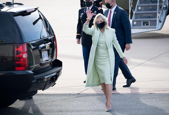 <p>Arriving at Delaware Air Guard National Base, Dr. Biden continued her pattern of matching coats to dresses. Here, she's seen wearing a pale green belted dress and jacket. </p>