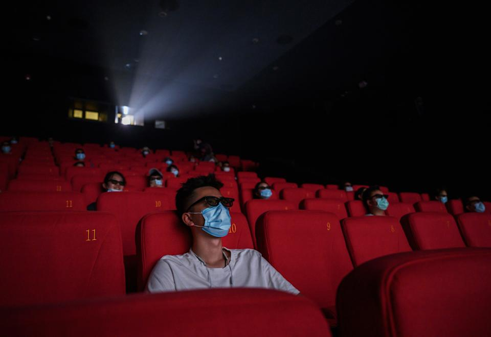 People wear protective masks as they watch a movie in 3D at a theatre in Beijing, China (Getty Images)