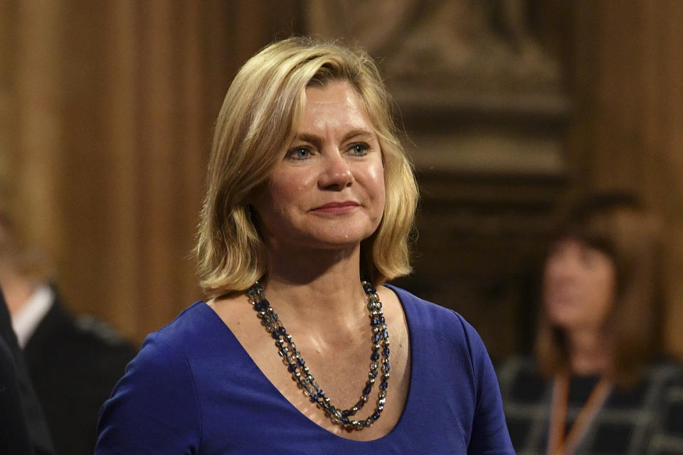 Justine Greening in the Central Lobby as she walks back to the House of Commons after the Queen's Speech during the State Opening of Parliament ceremony in London.