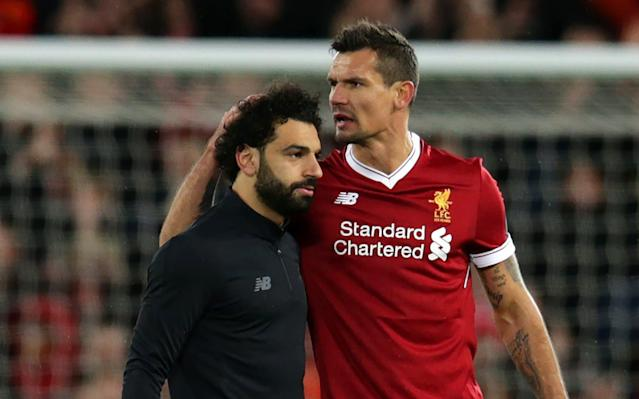 "Dejan Lovren says Mohamed Salah deserves to be a leading candidate for the Ballon d'Or having elevated himself to the status of Lionel Messi and Cristiano Ronaldo this season. The La Liga superstars have dominated the European Player of the Year awards for the last 11 years. Now they have a rival, according to the Liverpool defender. ""Forty-three goals. F***ing hell,"" said Lovren, summing up the disbelief as much as admiration at Salah's achievement. ""I don't know if this is the right time to put pressure on him but I believe he should be regarded as one of the best three in the world at the end of the year. He deserves it how he is doing right now. ""He deserves to be mentioned for the Ballon d'Or – when people talk about Messi and Ronaldo they should also talk about Salah. He deserves the credit but I think he deserves even more, to be honest. Football fwend: Dejan Lovren marvels at Mohamed Salah's skills in training Credit: iverpool FC via Getty Images ""He is becoming the superstar. It looks easy what he does but it is very difficult. We help him, the manager helps and this style of play helps him a lot. He didn't play that style before at Basel, Chelsea and Roma. They had different styles and this style suits him perfectly. Hopefully he can stay injury free."" Roma left Merseyside hopeful of completing the most extraordinary comebacks after two late goals, the tie seeming over when Liverpool took a five goal lead. But Lovren believes Jurgen Klopp's side will head to the Stadio Olimpico seeking victory on the night. An example to us all: Lovren and Mo Salah train Credit: Liverpool FC via Getty Images ""I am still confident that we can score there,"" he said. ""We had so many chances. They are really open. They are a team that likes to play and that is good for us. They now need to score. It will be a crazy atmosphere but we played in one similar at Man City and we know what we need to do. If we score quite early I think it will be a quite different. I am really quite confident we will have chances again. ""With our attack, how we did it, I am not even worried. ""We had so much space it was incredible. I couldn't believe they let us have so much space with these players – the front three. ""You feel powerful to be in this team, you feel strong when you look around and see the players next to you. We have big names, we don't maybe have lots of 'superstars,' but it is not about the name. It is how we perform on the pitch. liverpool roma grid ""You can see the system working, definitely. Every training session, every game we feel we are more comfortable and more confident. We juts need to learn from our previous mistakes. The last 15 minutes we were tired. We have to be more controlling of the game. That is where we need to improve."" Lovren was reminded Barcelona lost 3-0 in Rome despite a first leg lead. ""We are not Barcelona. We play different football to Barca,"" he said. ""We are a team who will not think about these five goals that we scored today. We will go there like a 0-0 game and we know we have these 90minutes to make history again. We know what we need to do."" The gold standards: is Mo Salah in the same league as Ronaldo and Messi? Credit: AFP/Getty Images Klopp was in a less relaxed mood after the game than before, once more reminding his players of the work to do to reach Kiev. ""He has his own vision about us, how he sees us. If it is not good he will tell you it is not good. If you are good, he tells you you are good and then it gives you the confidence to move on,"" said Lovren. ""This is how he did it with me and how he did it with a couple of other players and how is did that with the team. He will say for sure it was brilliant, but he is never satisfied. Something perfect does not exist. I would say that keeps us going."""