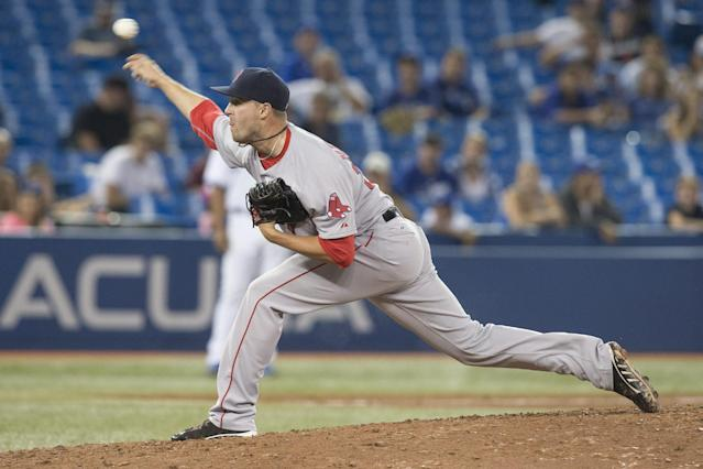 Boston Red Sox's Heath Hembree works against Toronto Blue Jays during the 11th inning of a baseball game Tuesday, Aug. 26, 2014, in Toronto. Boston won 11-7. (AP Photo/The Canadian Press, Chris Young)