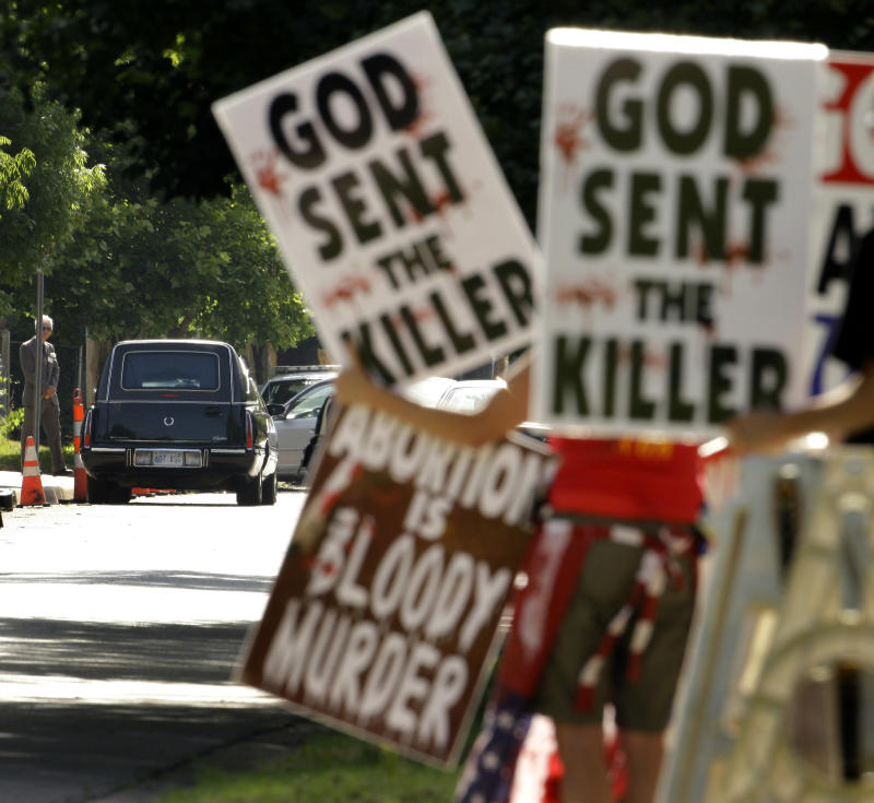 FILE - In this June 6, 2009 file photo, protesters from Rev. Fred Phelps' Westboro Baptist Church demonstrate during funeral services for Dr. George Tiller at College Hill United Methodist Church in Wichita, Kan. In an 8-1 ruling, the U.S. Supreme Court ruled the group's protests were protected by the First Amendment. The father of a Marine killed in Iraq sued after they picketed his son's 2006 funeral service.(AP Photo/Charlie Riedel, File)
