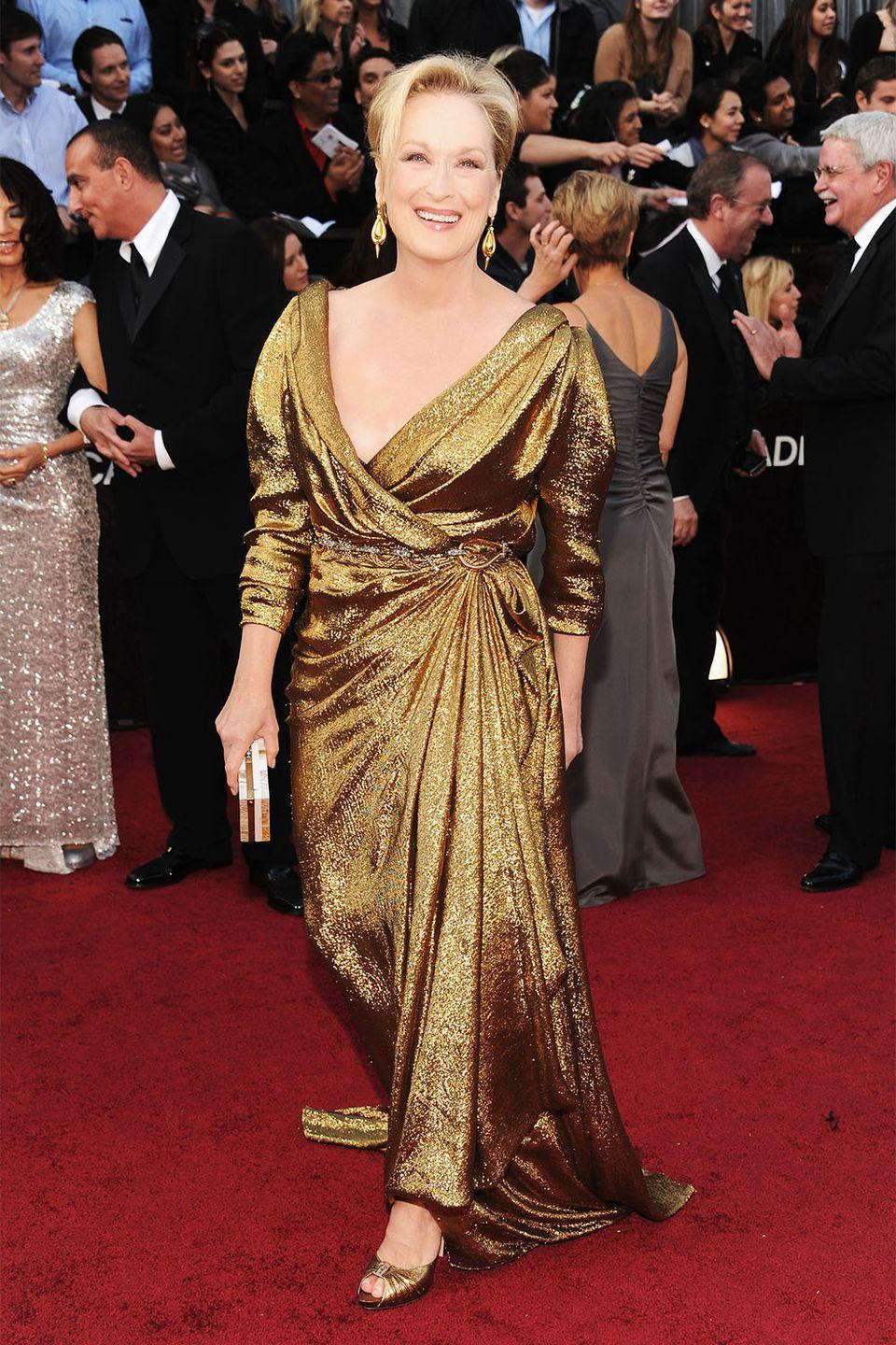 <p>Lanvin was always a go-to for Meryl Streep, and this gilded number was quite bold for the actress who always took a minimal approach to style. Streep also took home the gold for <em>The Iron Lady</em> that year. </p>