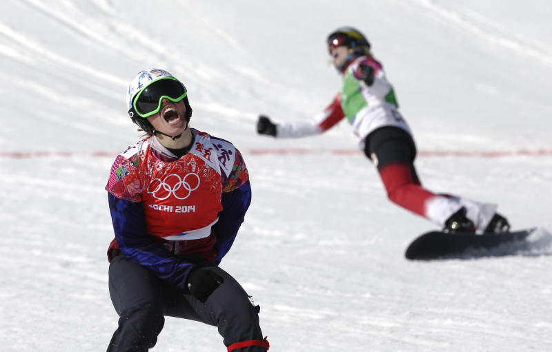 Czech Republic's Eva Samkova, left, celebrates after taking the gold medal in the women's snowboard cross final, ahead of silver medalist Dominique Maltais of Canada, right, at the Rosa Khutor Extreme Park, at the 2014 Winter Olympics, Sunday, Feb. 16, 2014, in Krasnaya Polyana, Russia. (AP Photo/Andy Wong)