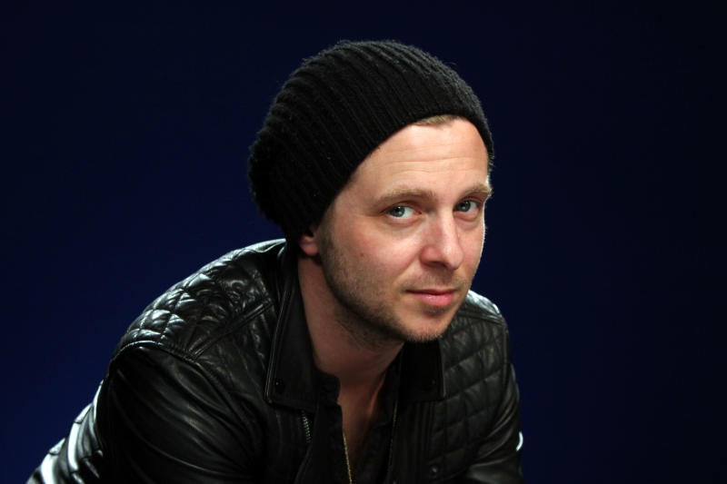 """FILE - This Feb. 27, 2013 file photo shows OneRepublic frontman Ryan Tedder in New York. Beyonce released her self-titled album in surprise form on Friday, Dec. 13. Tedder produced the single """"XO"""" and he learned about the release not long before it went public. In just three days, """"Beyonce"""" sold more than 617,000 units on the U.S. iTunes Store, where it was released exclusively. The album also features collaborations with Jay Z, Justin Timberlake, Miguel, Timbaland, Pharrell and Frank Ocean. Tedder previously produced Beyonce's Grammy-winning hit, """"Halo."""" (AP Photo/John Carucci, File)"""