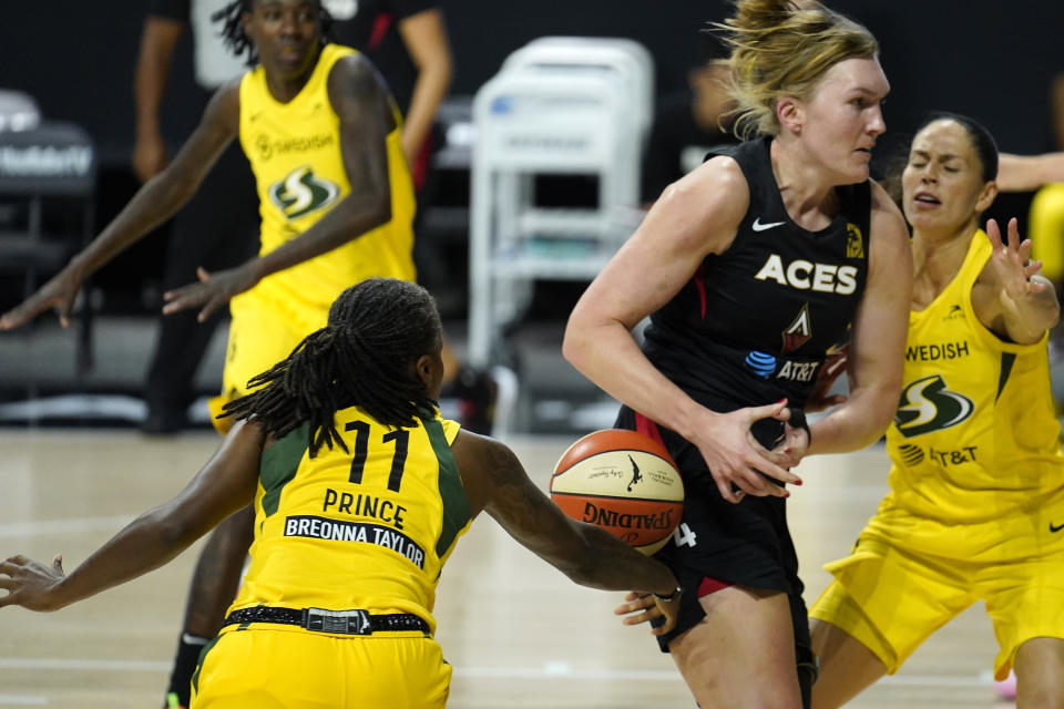 Seattle Storm guard Epiphanny Prince (11) stripes the ball from Las Vegas Aces center Carolyn Swords (4) during the first half of Game 1 of basketball's WNBA Finals Friday, Oct. 2, 2020, in Bradenton, Fla. (AP Photo/Chris O'Meara)