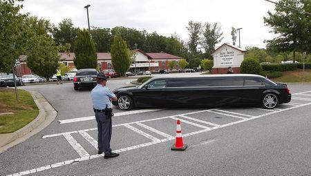 Family members arrive by police escort for the funeral of Kristina Bobbi Brown, the only child of singer Whitney Houston at Saint James United Methodist Church in Alpharetta, Georgia August 1, 2015. REUTERS/Tami Chappell