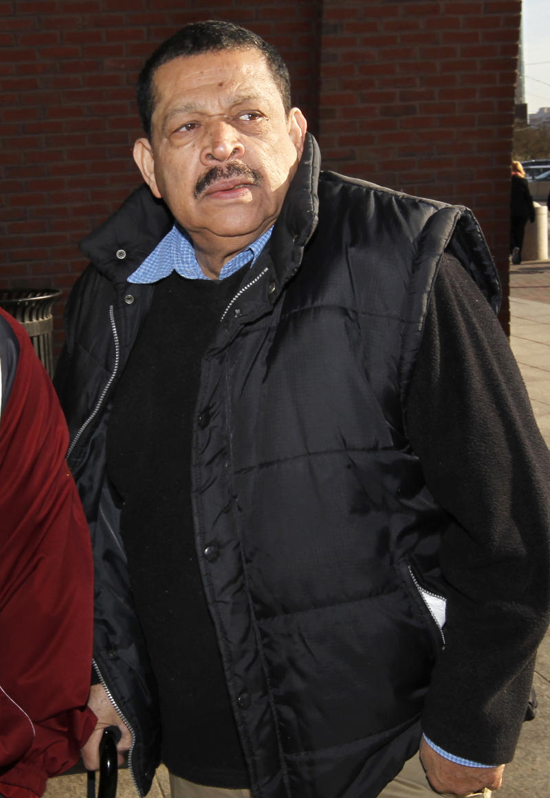 FILE - In this Dec. 19, 2011 file photo, Inocente Orlando Montano, a former Salvadoran military officer, arrives at federal court in Boston.  On Tuesday, Jan. 15, 2013, a federal judge in Boston delayed Montano's immigration fraud sentencing. Montano is accused of playing a role in the 1989 slayings of six Jesuits priests during his country's civil war. (AP Photo/Steven Senne, File)