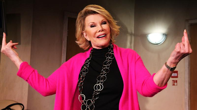 "Joan Rivers gestures during a photocall for her play ""A Work in Progress by a Life in Progress"" at the Leicester Square Theatre on September 2, 2008 in London. (Chris Jackson/Getty Images)"