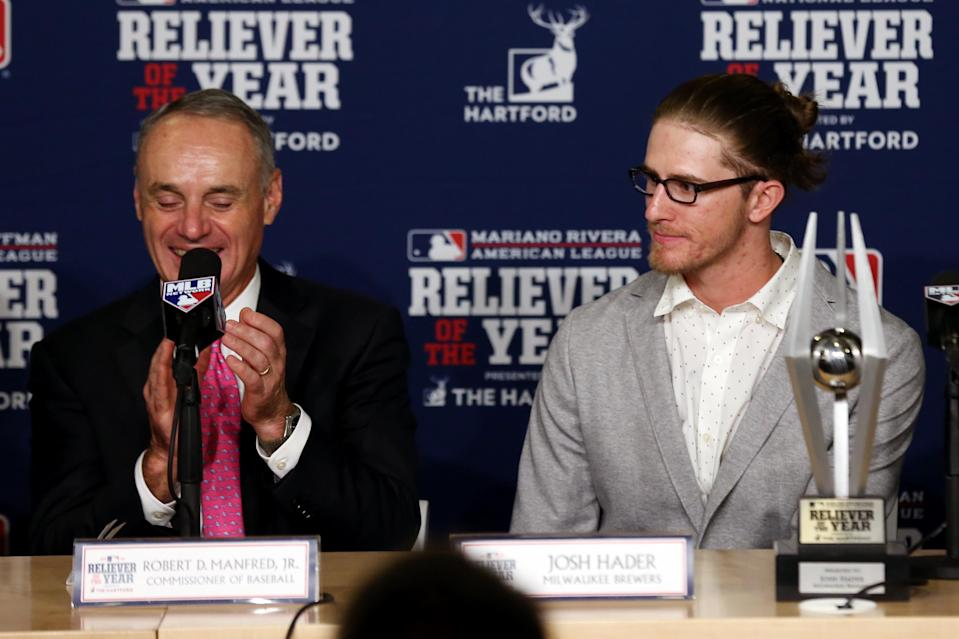 National League Reliever of the Year Josh Hader of the Milwaukee Brewers and MLB commissioner Rob Manfred prior to Game 4 of the World Series. (Getty Images)