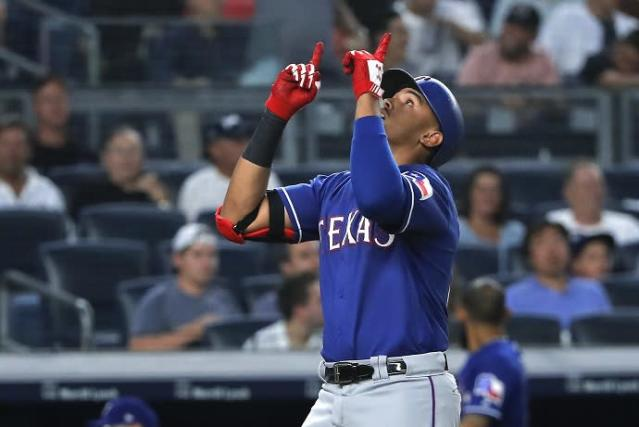 Texas Rangers' rookie Ronald Guzman continued killing the Yankees with a three-homer game Friday night. (AP)