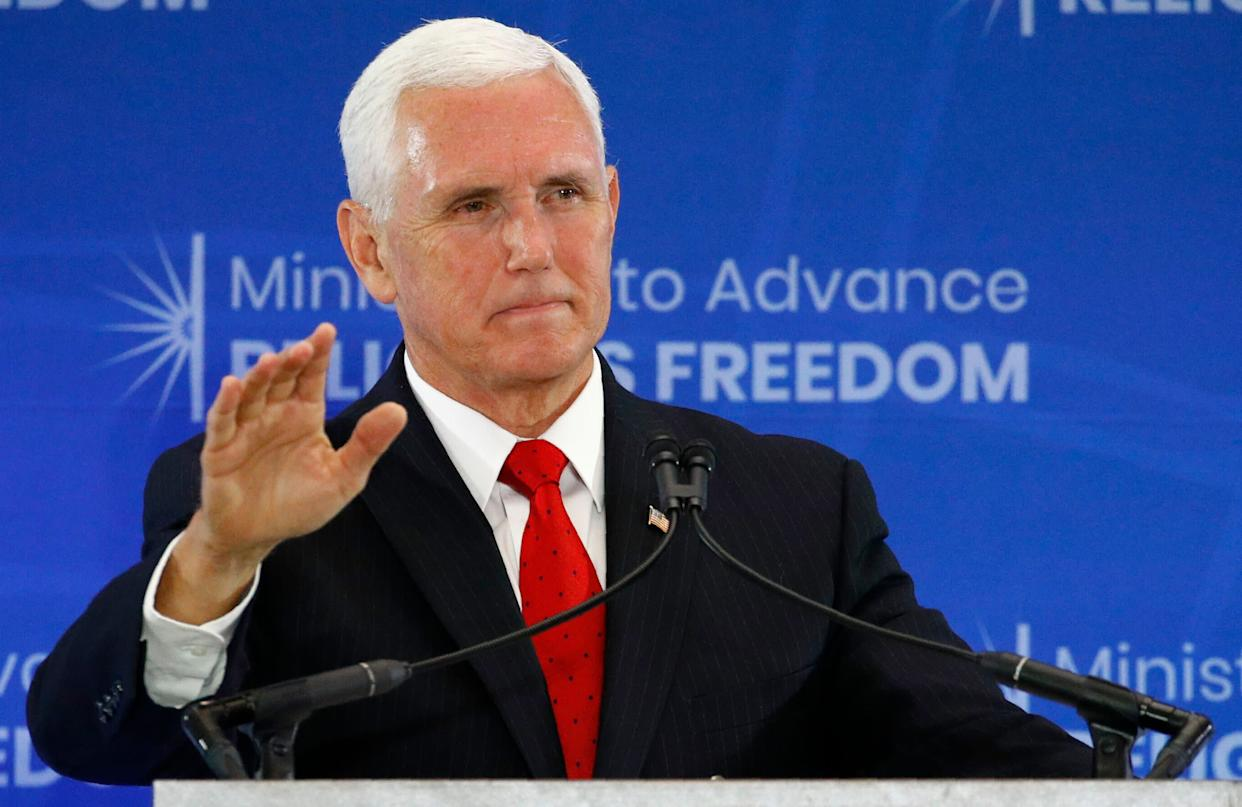 Nothing to worry about. Mike Pence was just staying far away from an alleged drug dealer. (Photo: ASSOCIATED PRESS)