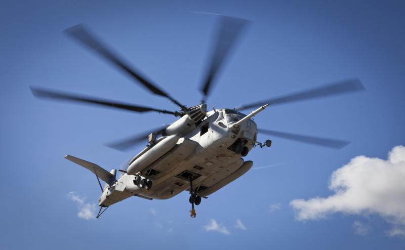A CH-53E Super Stallion, used by the Marine Heavy Helicopter Squadron 463,prepares to carry off a U.S. Army Huey Helicopter during a sling load operation aboard Barber's Point Naval Air Station, Marine Corps Base Hawaii on September 23, 2014, in this handout photo provided by the U.S. Marine Corps. The U.S. Coast Guard is searching for two Marine helicopters carrying 12 people after reports that they collided near the island of Oahu in Hawaii, media reports said on January 15, 2016. REUTERS/U.S. Marine Corps/Lance Cpl. Aaron S. Patterson/Handout via Reuters  ATTENTION EDITORS - FOR EDITORIAL USE ONLY. NOT FOR SALE FOR MARKETING OR ADVERTISING CAMPAIGNS. THIS IMAGE HAS BEEN SUPPLIED BY A THIRD PARTY. IT IS DISTRIBUTED, EXACTLY AS RECEIVED BY REUTERS, AS A SERVICE TO CLIENTS