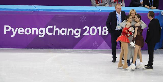 Figure Skating - Pyeongchang 2018 Winter Olympics - Women Single Skating free skating competition final - Gangneung Ice Arena - Gangneung, South Korea - February 23, 2018 - Gold medallist Alina Zagitova and silver medallist Evgenia Medvedeva, Olympic athletes from Russia, celebrate with their team leaders. REUTERS/Lucy Nicholson