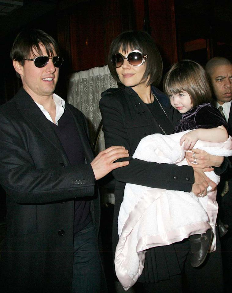 """Tom Cruise, Katie Holmes, and their daughter Suri were greeted by the paparazzi as they exited French brasserie Orsay on Wednesday. An unauthorized biography of Cruise was released earlier in the week. In it, author Andrew Morton claims the actor ranks second in command in the Church of Scientology. <a href=""""http://www.infdaily.com"""" target=""""new"""">INFDaily.com</a> - January 16, 2008"""