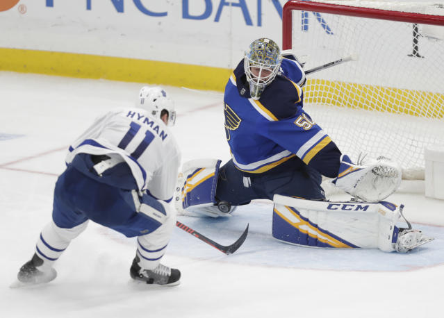 St. Louis Blues goaltender Jordan Binnington (50) makes a save on a point-blank shot from Toronto Maple Leafs' Zach Hyman (11) during the third period of an NHL hockey game Tuesday, Feb. 19, 2019, in St. Louis. The Blues won 3-2 in overtime. (AP Photo/Tom Gannam)
