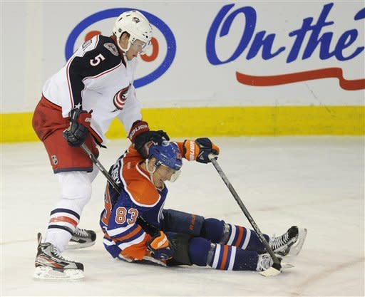 Columbus Blue Jackets Aaron Johnson, left, pushes Edmonton Oilers' Ales Hemsky at the end of the third period of NHL action in Edmonton, Alberta, on Wednesday, March 14, 2012. The Oilers scored a 3-0 shutout win over the Blue Jackets. (AP Photo/THE CANADIAN PRESS/John Ulan)