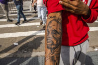 "Aaron Baines, 22, shows off his recent tattoo of rapper DMX at Barclays Center, Saturday, April. 24, 2021, in the Brooklyn borough of New York. DMX, whose birth name is Earl Simmons, died April 9 after suffering a ""catastrophic cardiac arrest."" (AP Photo/Brittainy Newman)"