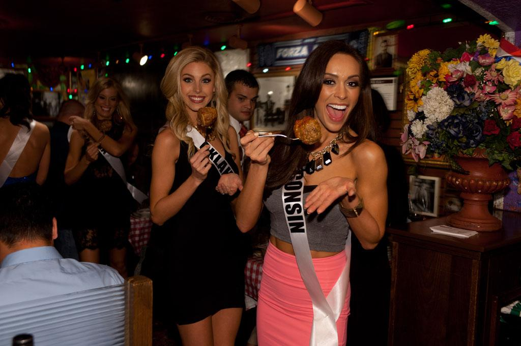 Miss Oklahoma USA 2013, Makenzie Muse; and Miss Wisconsin USA 2013, Chrissy Zamora; enjoy the welcome dinner at Buca di Beppo in Las Vegas, Nevada on Wednesday June 5, 2013.