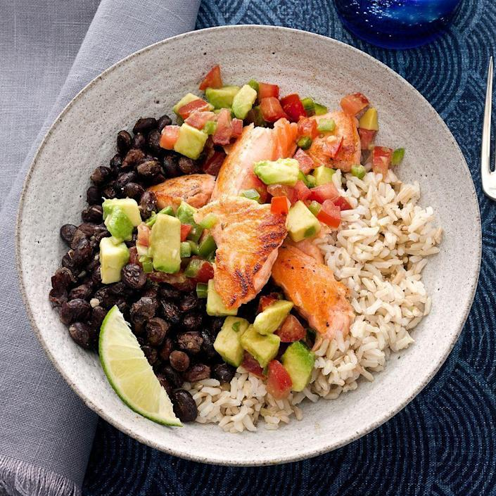 """<p>This protein-packed bowl gets topped with a zesty mix of avocado, tomato, jalapeño and lime juice.</p><p><em><a href=""""https://www.prevention.com/food-nutrition/recipes/a34099119/tex-mex-salmon-bowl-recipe/"""" rel=""""nofollow noopener"""" target=""""_blank"""" data-ylk=""""slk:Get the recipe from Prevention »"""" class=""""link rapid-noclick-resp"""">Get the recipe from Prevention »</a></em></p>"""