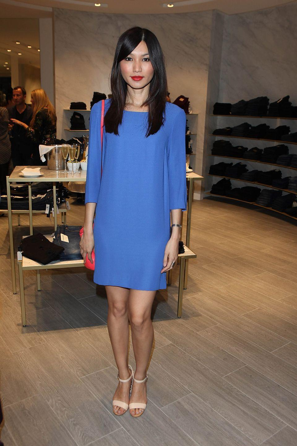<p>An uber sweet blue shift dress is the hero of the story in this photo of Chan at the Trilogy Chelsea Flagship Store, 2013</p><p>The actress contrasted the dress with a neon shoulder bag and nude 'barely there' heels.</p>