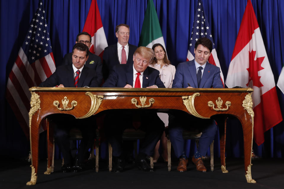 President Donald Trump, Canada's Prime Minister Justin Trudeau, right, and Mexico's President Enrique Pena Nieto, left, participate in the USMCA signing ceremony. (Photo: AP Photo/Pablo Martinez Monsivais)