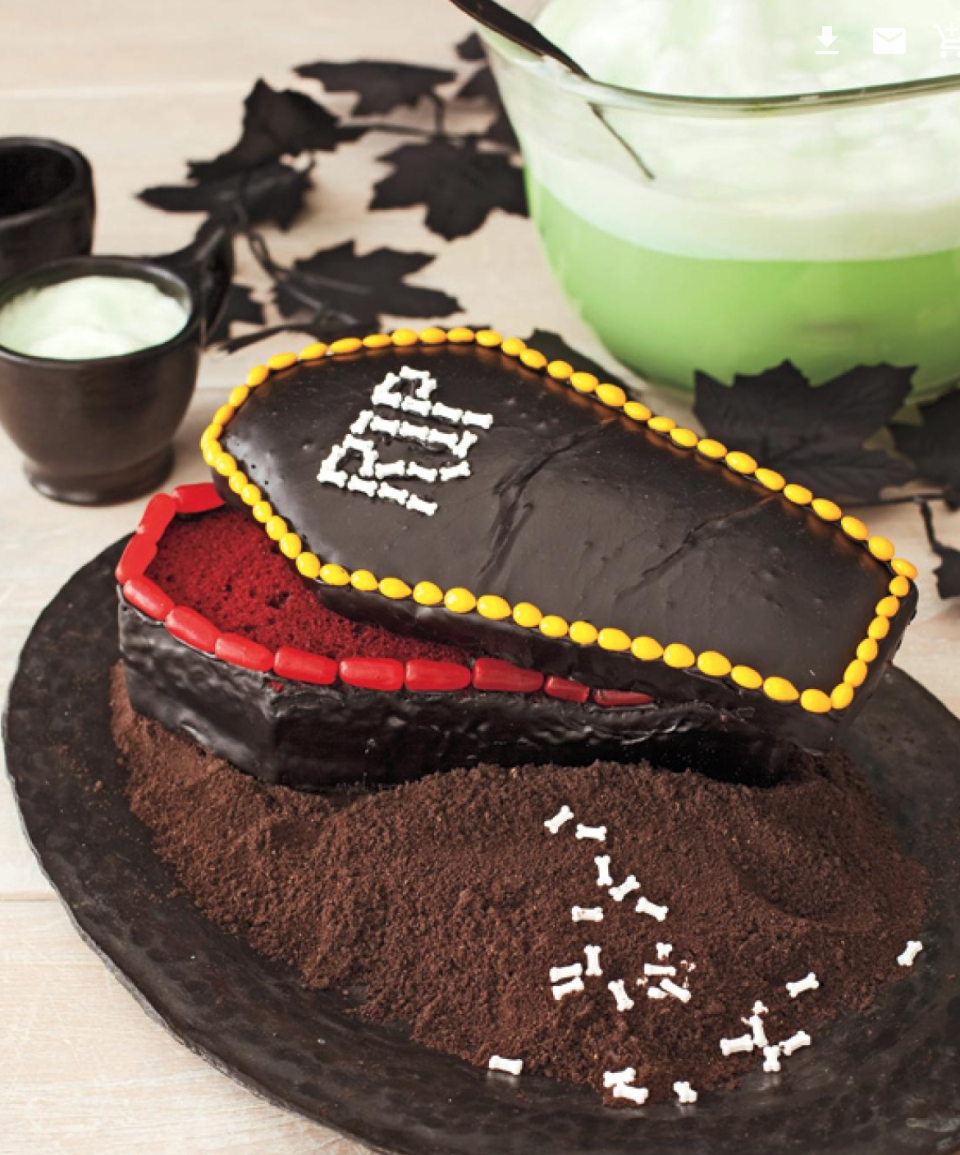 """<p>A truly frightening good cake, your guests will love the combo of red velvet cake and licorice candy.</p><p><em><a href=""""https://www.womansday.com/food-recipes/food-drinks/recipes/a11307/coffin-cake-recipe-122711/"""" rel=""""nofollow noopener"""" target=""""_blank"""" data-ylk=""""slk:Get the Coffin Cake recipe."""" class=""""link rapid-noclick-resp""""><strong>Get the Coffin Cake recipe.</strong></a></em></p>"""