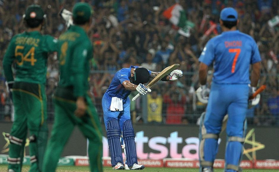 World T20, India vs Pakistan Photos: Kohli's bow to the God, Amitabh's rendition of National Anthem and Dhoni's winning runs-Sports News , Firstpost