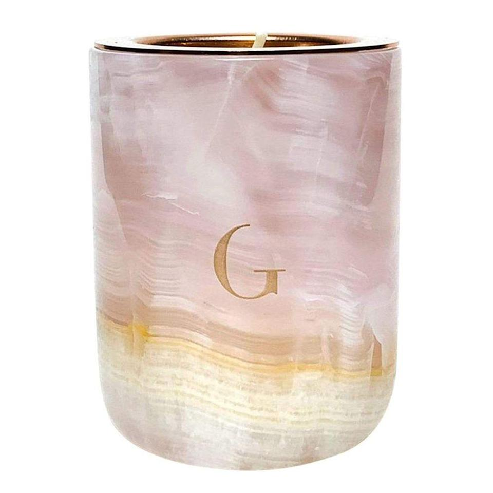 "<p>gildedbody.com</p><p><strong>$68.00</strong></p><p><a href=""https://gildedbody.com/collections/the-marble-candle/products/pink-onyx-marble-candle"" rel=""nofollow noopener"" target=""_blank"" data-ylk=""slk:Shop Now"" class=""link rapid-noclick-resp"">Shop Now</a></p><p>Crafted with beautiful marble, this candle is the ideal house-warming gift for a friend. Each container is hand-poured and refillable, so you can reuse again and again. </p>"