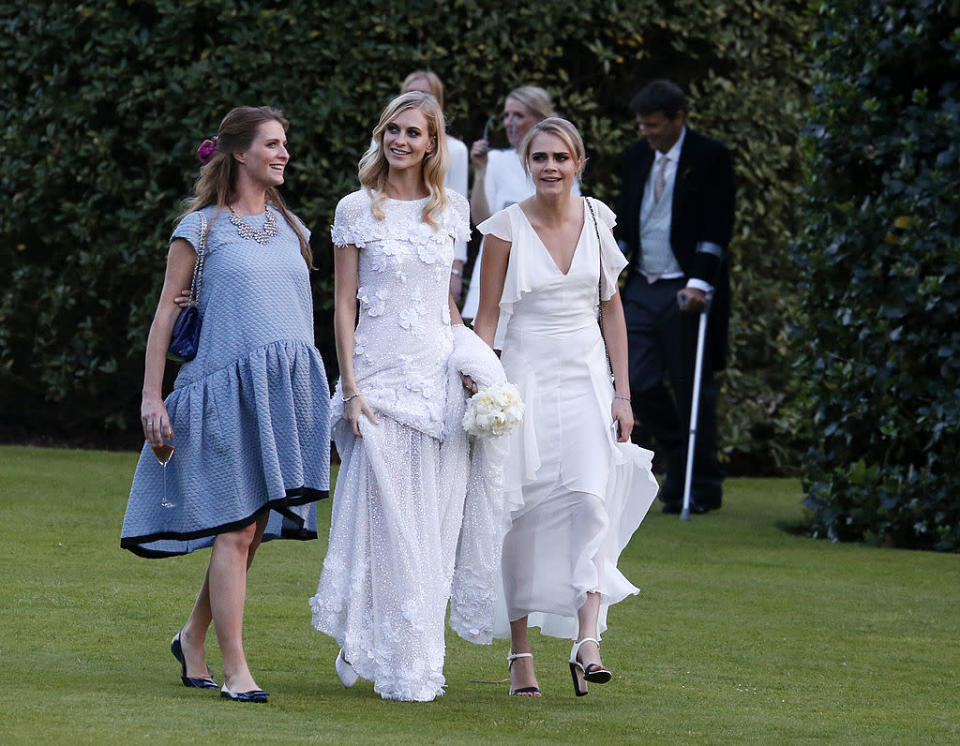 <p>Standing up for her big sister Poppy's wedding back in 2014, this was one of the rare times the young model was not the centre of attention. <i>(Photo by William Parker/GC Images)<br></i></p>