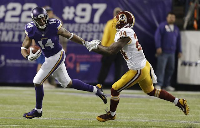Minnesota Vikings wide receiver Joe Webb, left, runs from Washington Redskins strong safety Bacarri Rambo during the first half of an NFL football game Thursday, Nov. 7, 2013, in Minneapolis. (AP Photo/Charlie Neibergall)
