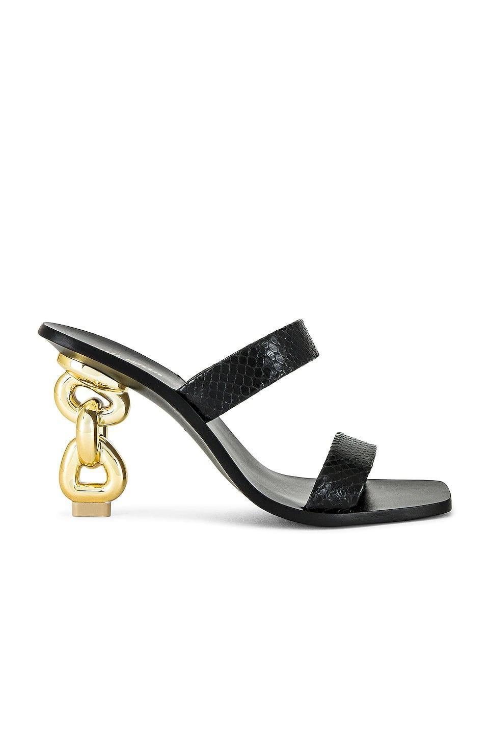 <p>These <span>Cult Gaia Vivianne Sandals</span> ($428) look like your classic black sandal from the front. The chain link heel, though, tells a different story, and adds a fun detail to a staple shape.</p>