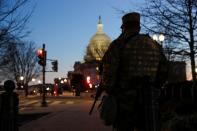 A member of the U.S. National Guard stands guard near the U.S. Capitol Building on Capitol Hill in Washington