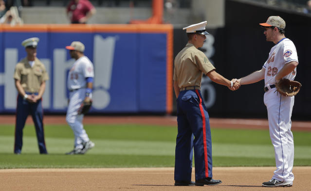 New York Mets second baseman Daniel Murphy (28) greets a Marine corporal before playing against the Pittsburgh Pirates in a baseball game, Monday, May 26, 2014, in New York. Military personnel from the U.S. Army, Navy, Air Force, Marine Corps and Coast Guard were honored before the game in recognition of Memorial Day. (AP Photo/Julie Jacobson)