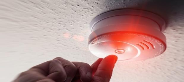 Smoke detectors are not just there to be waved at with a tea towel when you burn dinner. Learning why they make certain sounds, and how to act on those sounds, could save your life. (r.classen/Shutterstock - image credit)