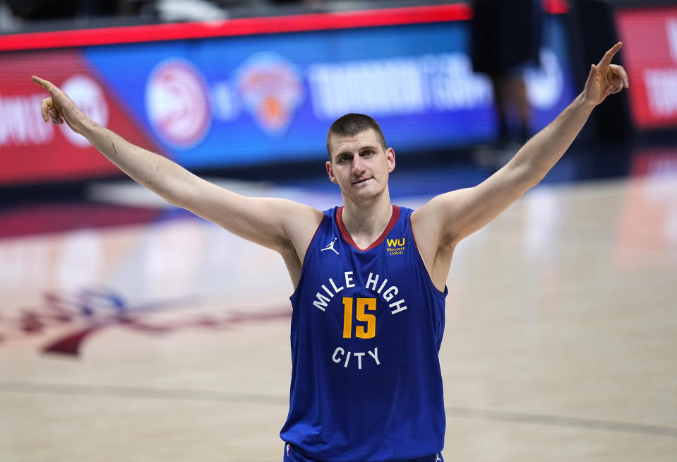 Denver Nuggets center Nikola Jokic (15) celebrate the team's double-overtime win against the Portland Trail Blazers in Game 5 of a first-round NBA basketball playoff series Tuesday, June 1, 2021, in Denver. (AP Photo/Jack Dempsey)