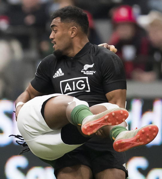 New Zealand's Tone Ng Shiu upends South Africa's Branco du Preez, back, during a semifinal match at the Canada Sevens rugby tournament in Vancouver, British Columbia, Sunday, March 8, 2020. (Darryl Dyck/The Canadian Press via AP)