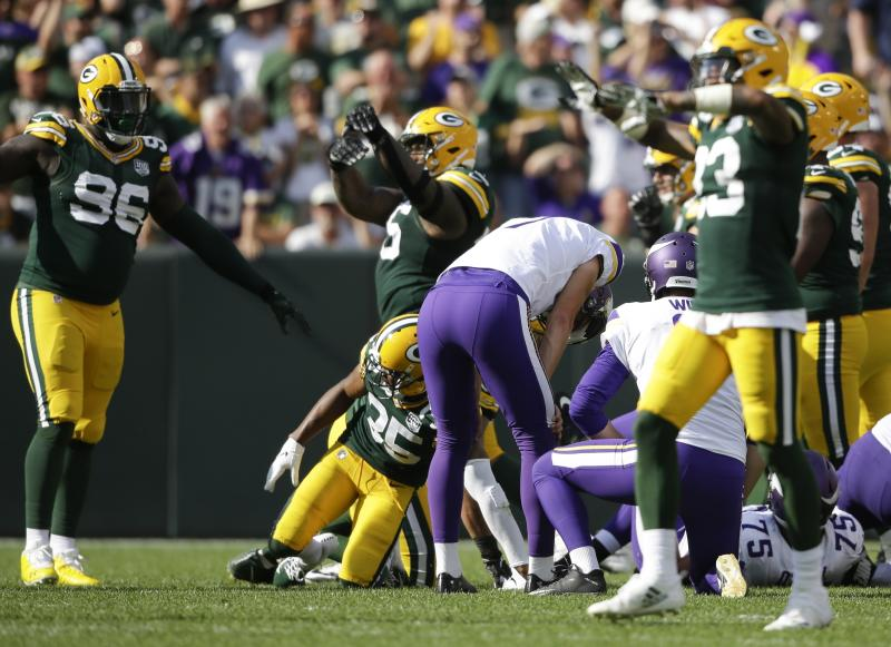 Minnesota Vikings kicker Daniel Carlson reacts after missing a field goal in the final sends of overtime an NFL football game against the Green Bay Packers Sunday Sept. 16 2018 in Green Bay Wis. The game ended in a 29-29 tie