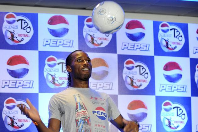 International football player Didier Drogba plays with a football during a press conference at a function in New Delhi on June17, 2012.  Didier Drogba is in the city for the grand finale of the Pepsi T20 football tournament.   AFP PHOTO/ SAJJAD HUSSAIN
