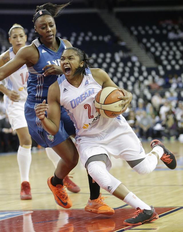Atlanta Dream's Alex Brantley (2) pushes to the basket as Minnesota Lynx' Monica Wright (22) defends during the first half of Game 3 of the WNBA Finals basketball series in Duluth, Ga., Thursday, Oct. 10, 2013. (AP Photo/John Bazemore)