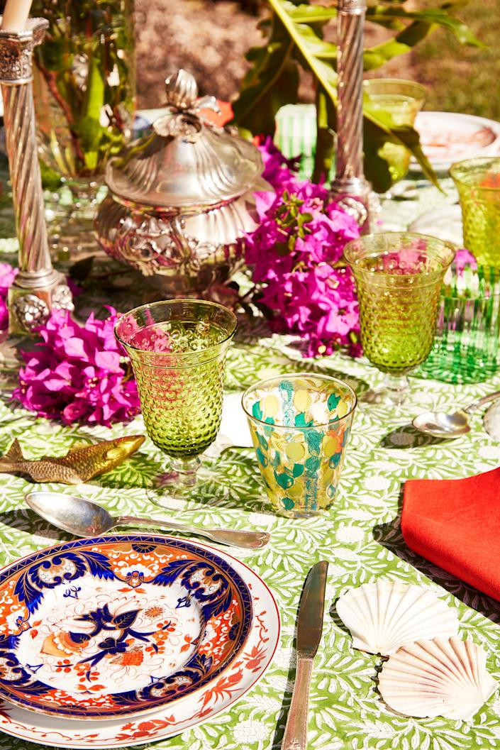 "<div class=""caption""> Colorful tabletop accessories atop an <a href=""https://amandalindroth.com"" rel=""nofollow noopener"" target=""_blank"" data-ylk=""slk:Amanda Lindroth"" class=""link rapid-noclick-resp"">Amanda Lindroth</a> tablecloth. </div> <cite class=""credit"">Pernille Loof</cite>"
