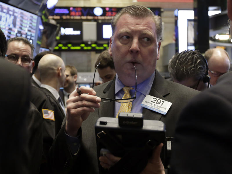 Trader Mathias Roberts works on the floor of the New York Stock Exchange Friday, Jan. 31, 2014. Stocks fell sharply in early trading Friday, as investors fretted over disappointing earnings from companies like Amazon.com and more trouble in overseas markets. (AP Photo/Richard Drew)