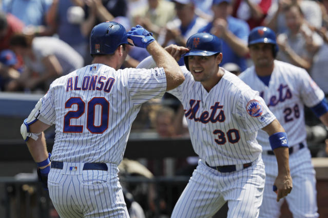 New York Mets' Pete Alonso, left, is met at home plate by teammate Michael Conforto after hitting a two-run home run against the Miami Marlins in the first inning of a baseball game, Wednesday, Aug. 7, 2019, in New York. (AP Photo/Mark Lennihan)