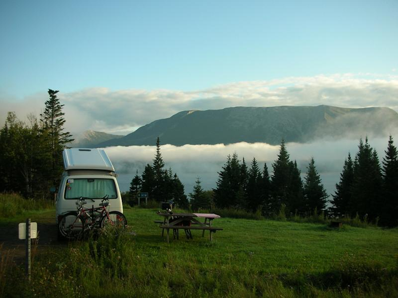 Camping offers lots of perks, like this gorgeous morning view, but you don't want to spend more than you need to make it happen. (Carlos Baquero/ Flickr