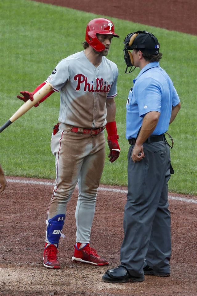 Philadelphia Phillies' Bryce Harper, left, argues a called third strike with home plate umpire Brian May in the sixth of a baseball game against the Pittsburgh Pirates, Sunday, July 21, 2019, in Pittsburgh. (AP Photo/Keith Srakocic)