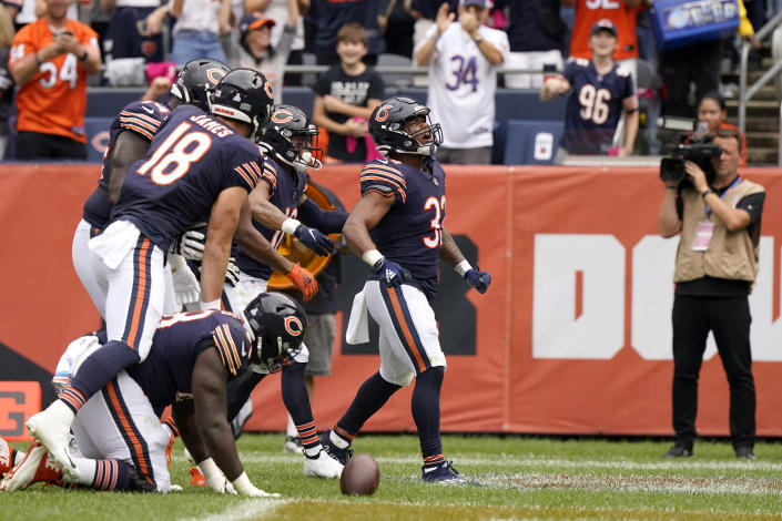 Chicago Bears running back David Montgomery (32) celebrates his touchdown with teammates during the first half of an NFL football game against the Detroit Lions Sunday, Oct. 3, 2021, in Chicago. (AP Photo/Nam Y. Huh)