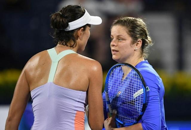 Clijsters says she is keen to continue despite her straight sets defeat to Muguruza (AFP Photo/KARIM SAHIB)