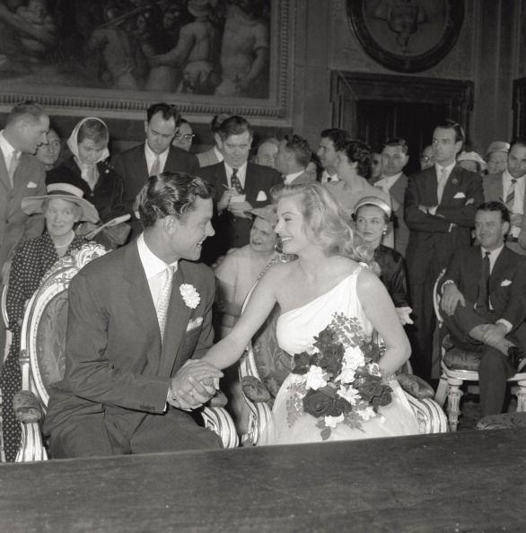<p>Anita Ekberg wore a modern one-shoulder wedding gown for her ceremony to English actor Anthony Steel. They were wed in Florence, Italy, at the Palazzo Vecchio. </p>